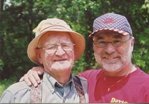 Wilson, right, with his father, Charles, enjoying the outdoors.